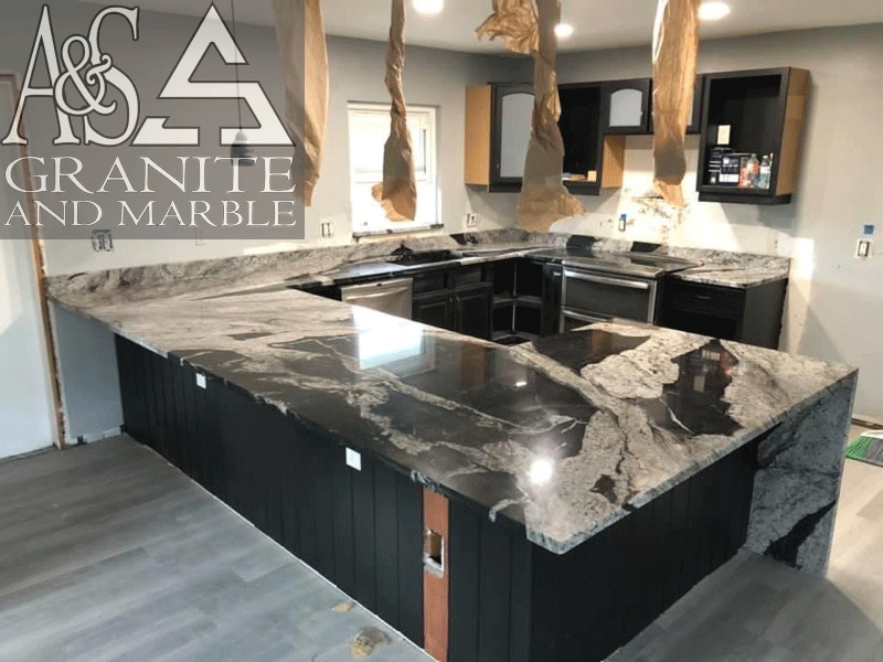 Beautiful polished finish black and white Waimeia Quartzite countertops - with mitered waterfall legs for countertops.
