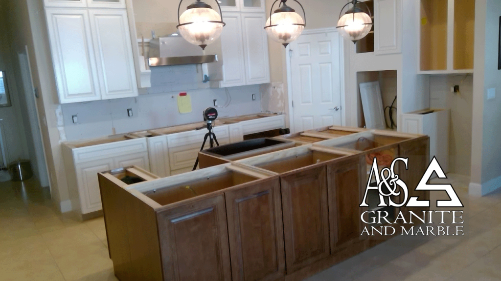 Kitchen Counetertops - Azurite island countertops - Taj Mahal surrounds with Full height backsplash - at time of template