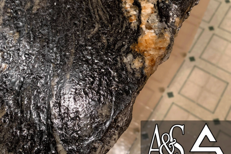 Magma Gold Chiseled Edge Really Pops With a Leathered Finish On These Countertops